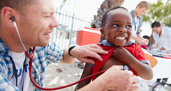Doctor examining a child. Photo: iStock.com